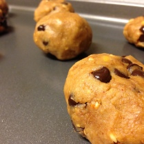Patiently waiting their descent into the oven, where chocolate and peanut butter collide in harmonious cookie delight.