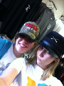 Only at a flea market can one try on hats like these.