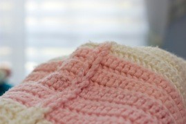 pink and white crochet blanket