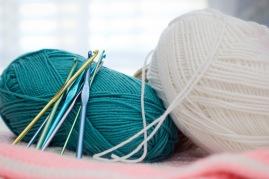 crochet tools and teal yarn